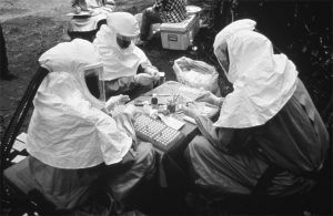 CDC and Zairian scientists take blood samples near Kikwit, Zaire, during the 1995 Ebola virus outbreak. CDC/Ethleen Lloyd.