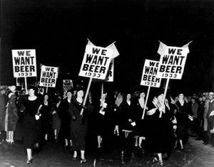 "Women turn out in large numbers, some carrying placards reading ""We want beer,"" for the anti prohibition parade and demonstration in Newark, N.J., Oct. 28, 1932. More than 20,000 people took part in the mass demand for the repeal of the 18th Amendment. (AP Photo)"